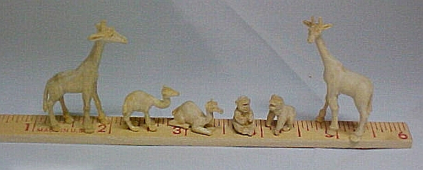 hand carved wood unpainted miniature animals