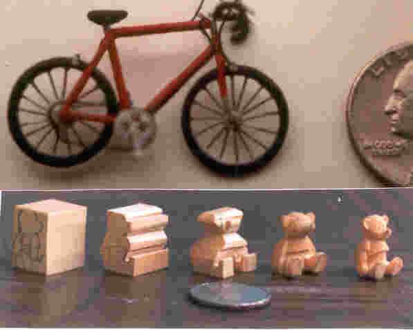 handcarved wooden miniature bike and bear progressing