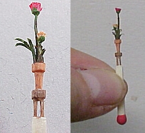 hand carved match stick- flowers in pot on a 4 legged table!