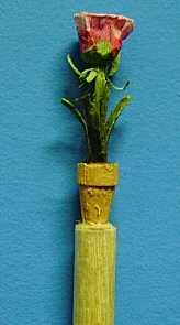 hand carved flower in a pot toothpick
