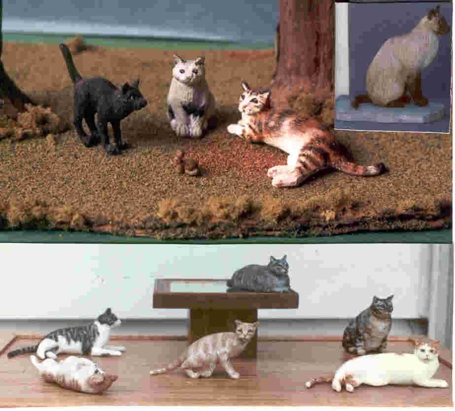 handcarved  wooden miniature cats